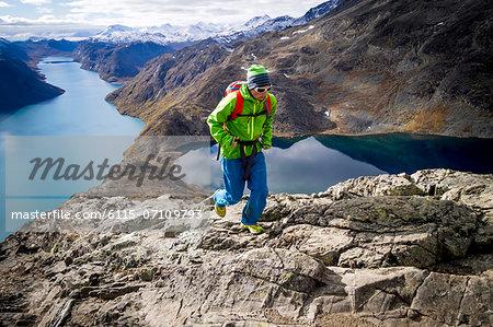 Man speed hiking along mountain trail, Norway, Europe