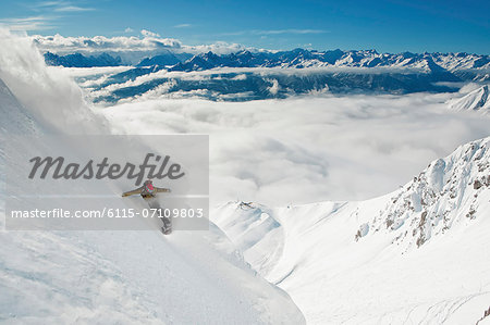 Snowboarder takes a powder turn, Innsbruck, Austria Stock Photo - Premium Royalty-Free, Image code: 6115-07109803