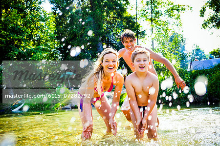 Family with child splashes in the river, foothills of the Alps, Bavaria, Germany Stock Photo - Premium Royalty-Free, Image code: 6115-07282792
