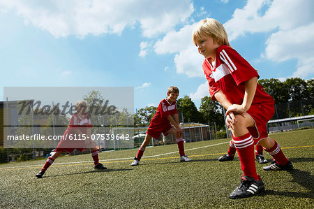 Group of boys at soccer training, stretching, Munich, Germany Stock Photo - Premium Royalty-Free, Image code: 6115-07539642