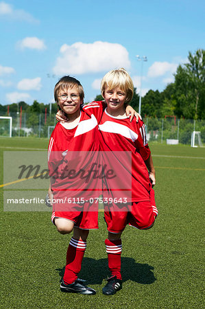 Two boys at soccer training, side by side, Munich, Germany Stock Photo - Premium Royalty-Free, Image code: 6115-07539643