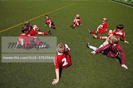 Group of boys at soccer training, stretching, Munich, Bavaria, Germany Stock Photo - Premium Royalty-Free, Image code: 6115-07539644