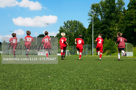 Group of boys at soccer training, running side by side, Munich, Bavaria, Germany Stock Photo - Premium Royalty-Free, Image code: 6115-07539647