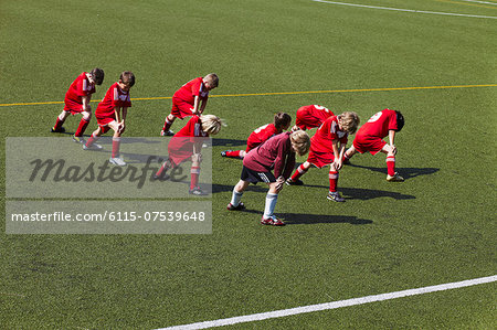 Group of boys at soccer training, stretching, Munich, Bavaria, Germany Stock Photo - Premium Royalty-Free, Image code: 6115-07539648