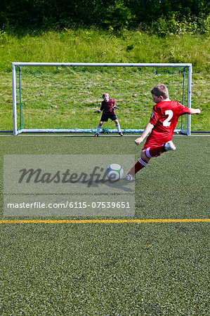 Boys at soccer training, exercising penalty kick, Munich, Bavaria, Germany Stock Photo - Premium Royalty-Free, Image code: 6115-07539651