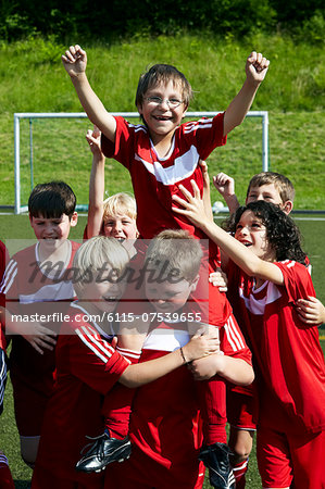 Group of boys at soccer training, cheering, Munich, Bavaria, Germany Stock Photo - Premium Royalty-Free, Image code: 6115-07539655
