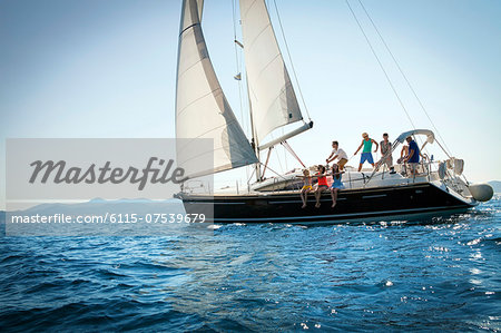 Young people sailing together, Adriatic Sea, Croatia Stock Photo - Premium Royalty-Free, Image code: 6115-07539679
