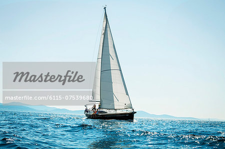 Young people sailing together, Adriatic Sea, Croatia Stock Photo - Premium Royalty-Free, Image code: 6115-07539680