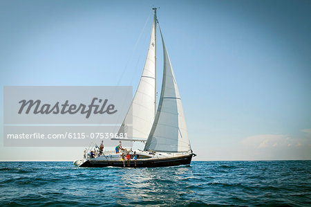 Young people sailing together, Adriatic Sea, Croatia Stock Photo - Premium Royalty-Free, Image code: 6115-07539681