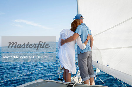 Mature couple on sailboat, looking at view, Adriatic Sea, Croatia Stock Photo - Premium Royalty-Free, Image code: 6115-07539698