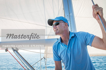 Mature man on sailboat, looking away, Adriatic Sea, Croatia