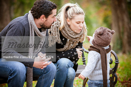 Family with son sitting on a park bench, Osijek, Croatia