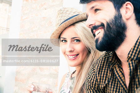 Portrait of happy young couple outdoors Stock Photo - Premium Royalty-Free, Image code: 6115-08100627
