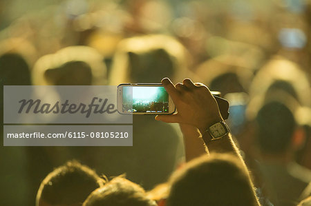 Young people having fun at music concert Stock Photo - Premium Royalty-Free, Image code: 6115-08105210