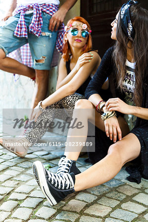 Young people in hippie style fashion Stock Photo - Premium Royalty-Free, Image code: 6115-08239889