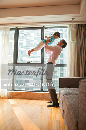 Father playing with his son Stock Photo - Premium Royalty-Free, Image code: 6116-06938672