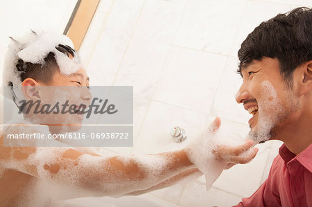 Son in Bathtub puts Soap on His Father's Face Stock Photo - Premium Royalty-Free, Image code: 6116-06938722