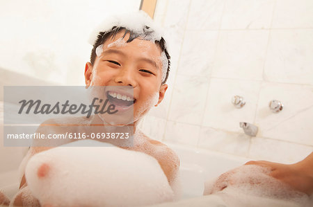 Close-up of Kid in Bubble Bath Stock Photo - Premium Royalty-Free, Image code: 6116-06938723