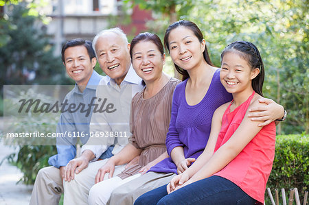 Three Generation Family Sitting in their Apartment Courtyard Stock Photo - Premium Royalty-Free, Image code: 6116-06938811