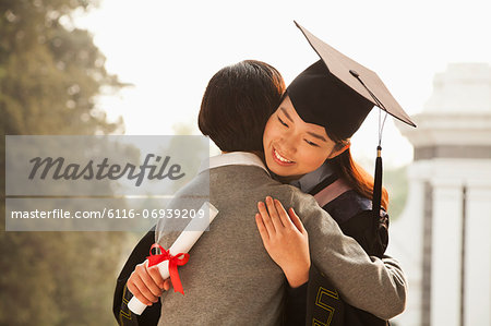 Mother and Graduate Hug Stock Photo - Premium Royalty-Free, Image code: 6116-06939209