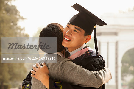 Mother and Graduate Hug Stock Photo - Premium Royalty-Free, Image code: 6116-06939210