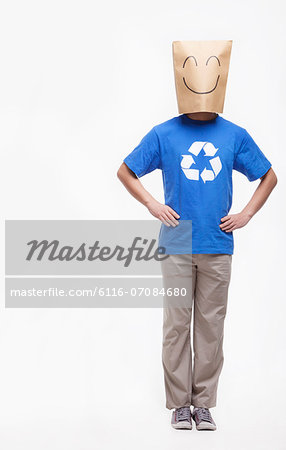 Young man with smiley face paper bag over his head Stock Photo - Premium Royalty-Free, Image code: 6116-07084680