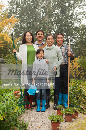 Happy family working in garden Stock Photo - Premium Royalty-Free, Image code: 6116-07086004