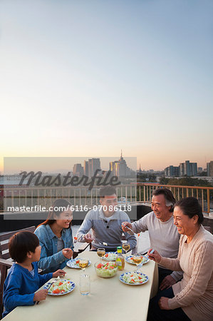 Family barbeque party Stock Photo - Premium Royalty-Free, Image code: 6116-07086118