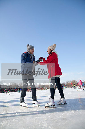 Young couple skating at ice rink Stock Photo - Premium Royalty-Free, Image code: 6116-07086569