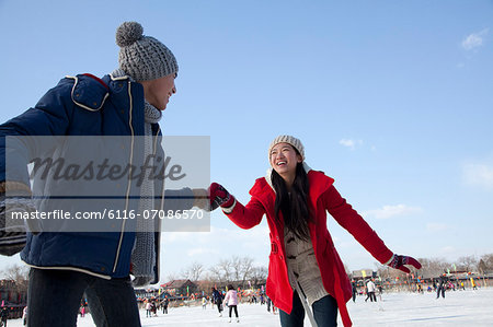 Young couple skating at ice rink Stock Photo - Premium Royalty-Free, Image code: 6116-07086570