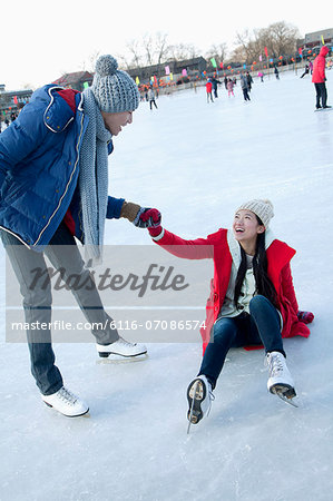 Young couple at ice rink Stock Photo - Premium Royalty-Free, Image code: 6116-07086574