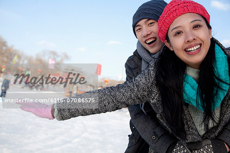 Young couple at ice rink Stock Photo - Premium Royalty-Free, Image code: 6116-07086575