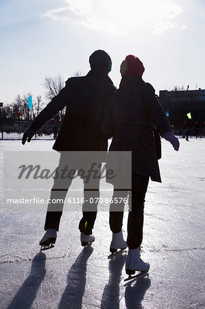Young couple at ice rink Stock Photo - Premium Royalty-Free, Image code: 6116-07086576