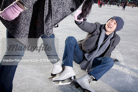 Young couple at ice rink Stock Photo - Premium Royalty-Free, Image code: 6116-07086579
