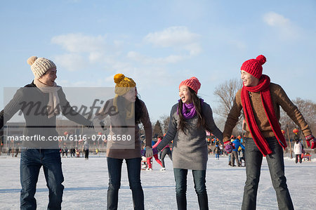 Friends on ice rink Stock Photo - Premium Royalty-Free, Image code: 6116-07086580