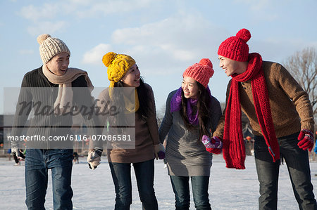 Friends on ice rink Stock Photo - Premium Royalty-Free, Image code: 6116-07086581