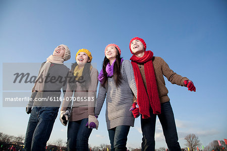 Friends on ice rink Stock Photo - Premium Royalty-Free, Image code: 6116-07086583
