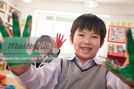 School children showing their hands covered in paint Stock Photo - Premium Royalty-Free, Image code: 6116-07235677