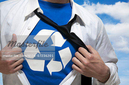Businessman with open short revealing shirt with recycling symbol underneath Stock Photo - Premium Royalty-Free, Image code: 6116-07236201