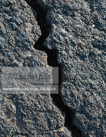 A Lava Field, With Black Solidified Rock Surface, With Fissures. Stock Photo - Premium Royalty-Free, Image code: 6118-07122110