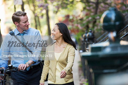 A Businesswoman And Two Businessmen Outdoors In The City. Stock Photo - Premium Royalty-Free, Image code: 6118-07122472