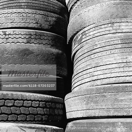 Close of a stack of discarded worn old automobile tyres, near Wendover in Utah. Stock Photo - Premium Royalty-Free, Image code: 6118-07203237