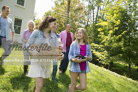 A family summer gathering at a farm. A shared meal, a homecoming. Stock Photo - Premium Royalty-Free, Image code: 6118-07235031