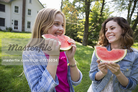 A family summer gathering at a farm. A shared meal, a homecoming. Stock Photo - Premium Royalty-Free, Image code: 6118-07235034