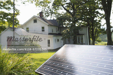 A solar panel in a farmhouse garden. Stock Photo - Premium Royalty-Free, Image code: 6118-07235245