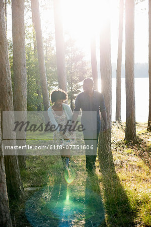 A happy couple in a shady spot in woodland in summer. Stock Photo - Premium Royalty-Free, Image code: 6118-07351606