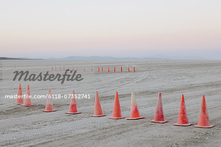 Row of traffic cones on the flat desert surface of  Black Rock, Nevada.