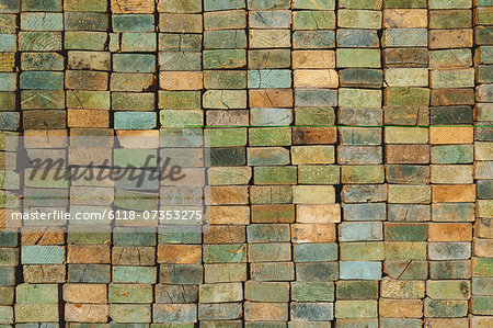 A stack of wood stud boards known as 2 x 4s. Used for construction and scaffolding. Stock Photo - Premium Royalty-Free, Image code: 6118-07353275