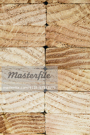 Stack of sawn prepared timber, spruce wood planks or studs, for use. Treated wood in traditional 2 by 4 measured cut shapes. Cut ends. Stock Photo - Premium Royalty-Free, Image code: 6118-07353279