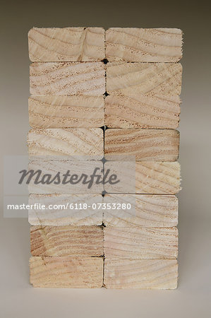 Stack of sawn prepared timber, spruce wood planks or studs, for use. Treated wood in traditional 2 by 4 measured cut shapes. Cut ends. Stock Photo - Premium Royalty-Free, Image code: 6118-07353280
